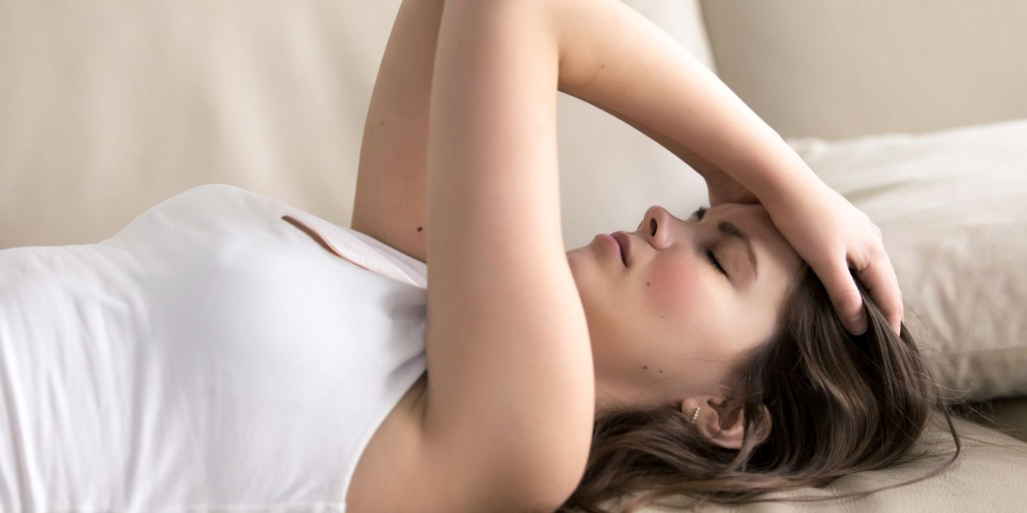 Young woman suffering of headache or migraine