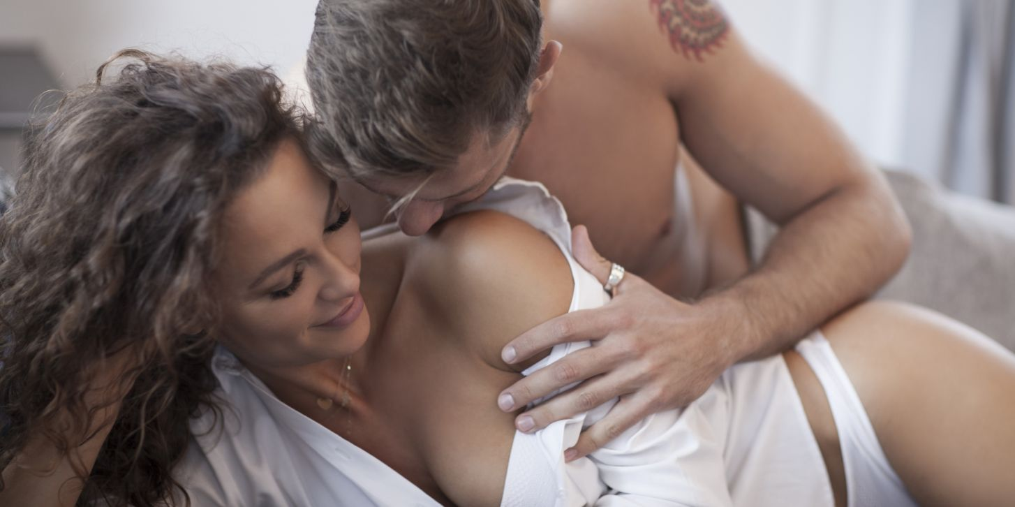 Intimate couple having a sex in the bed.