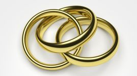 A chain of three golden rings, indicating polygamy
