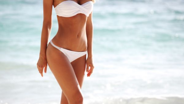 Woman body on beach background